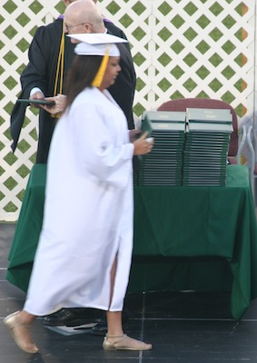 Ayanna walking across the stage