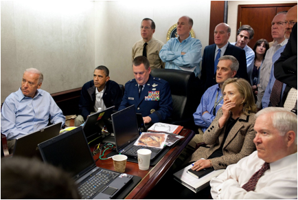 Description: https://upload.wikimedia.org/wikipedia/commons/thumb/a/ac/Obama_and_Biden_await_updates_on_bin_Laden.jpg/1920px-Obama_and_Biden_await_updates_on_bin_Laden.jpg
