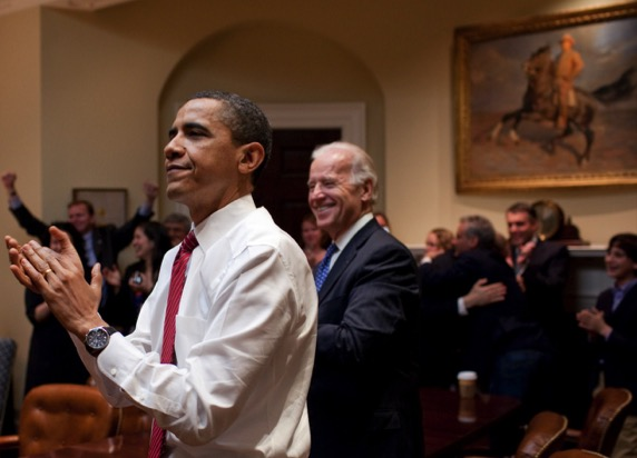 ...and whose picture is on the wall behind President Obama as they celebrate the passage of the healthcare bill?