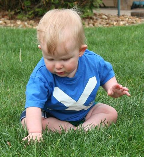 Owen playing in the grass