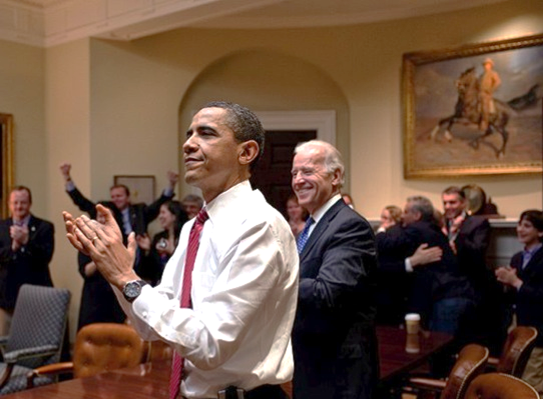 Barack Obama reacts to the passing of healthcare reform.