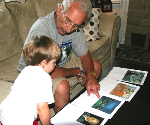 Al and Jack looking at prints