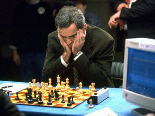 A meditative moment of an adult chess master