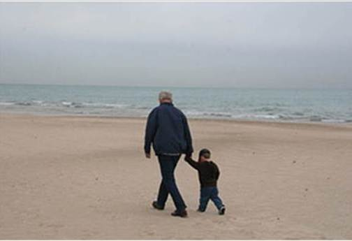 Al and Jack walking on the beach
