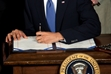 Obama signs health insurance reform bill