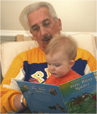 Description: Al reading to Owen