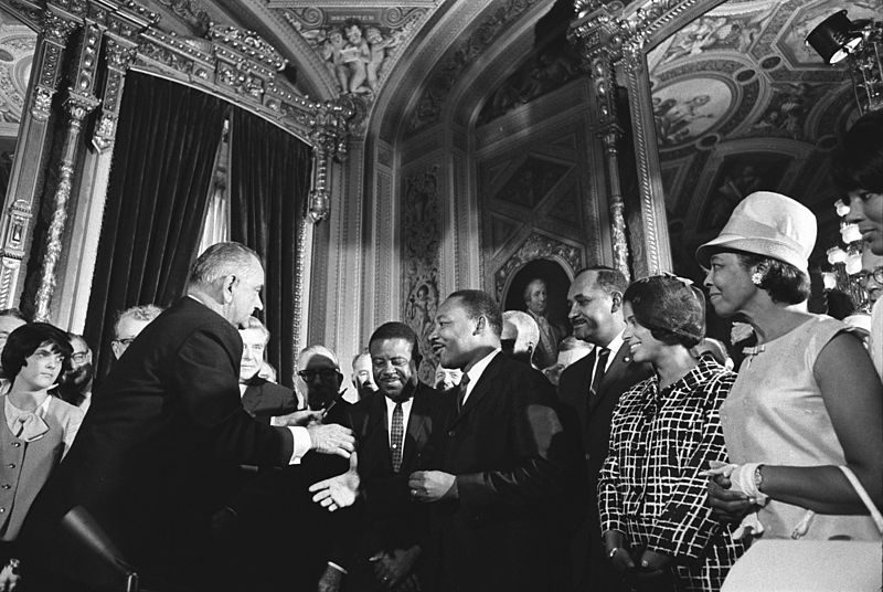 President Johnson, Martin Luther King, Jr. and Rosa Parks at the signing of the Voting Rights Act on August 6, 1965.