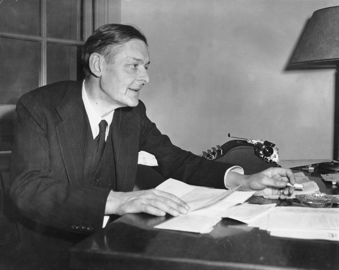 This is T. S. Eliot with his writing, typewriter, and cigarette.  He died due to lung problems related to his smoking.
