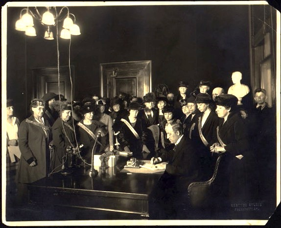 President Wilson signing the 19th Amendment