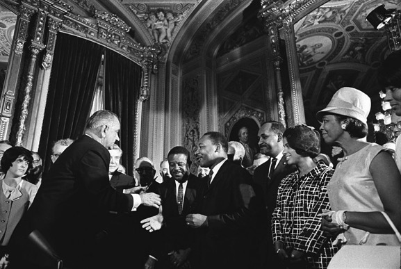 President Johnson, Martin Luther King, Jr., and Rosa Parks at the signing of the Voting Rights Act on August 6, 1965.