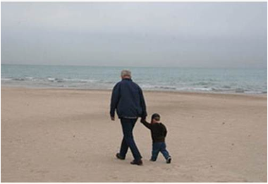 Description: Al and Jack walking on the beach